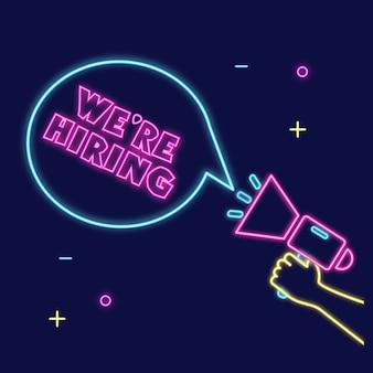 Neonowy znak megafonu trzymającego rękę ¡