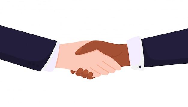 Nie dla rasizmu. uścisk dłoni biało-czarne ręce.