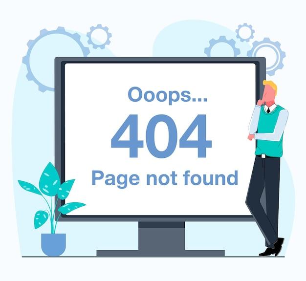 Nie znaleziono błędu 404 mężczyzna stoi obok monitora, na którym wyświetlany jest błąd 404