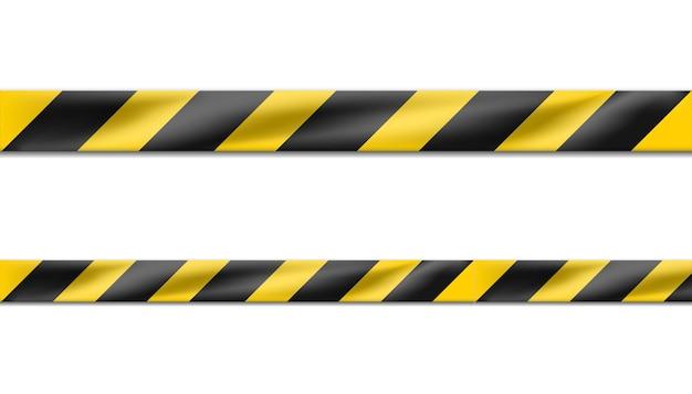 Niebezpieczna wstążka w czarne i żółte paski, taśma ostrzegawcza znaków ostrzegawczych na miejscu zbrodni lub placu budowy.
