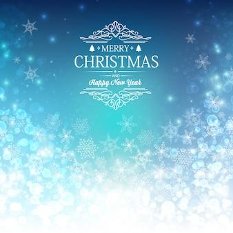 Niebieska kartka z życzeniami wesołych świąt i nowego roku z życzeniami, śnieżkami i innymi elementami dekoracyjnymi
