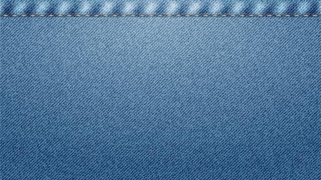 Niebieska klasyczna jeansowa dżinsowa tekstura ze szwem.
