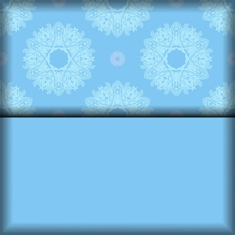 Niebieska pocztówka z rocznika białym ornamentem za gratulacje.
