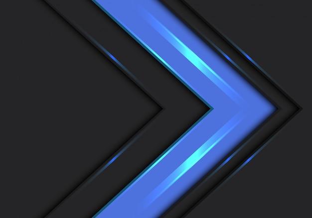 Niebieska strzałka kierunek prędkości na ciemnoszarym tle.