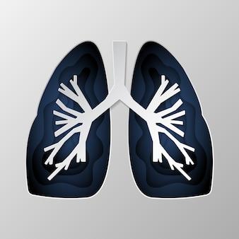 Niebieska sylwetka płuc wyrzeźbiona na papierze.