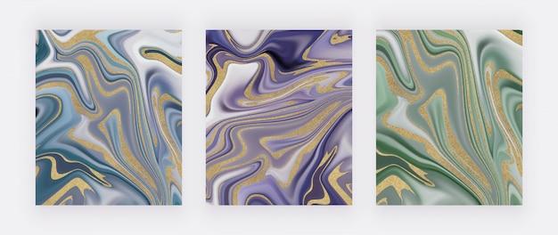 Niebieski, fioletowy i zielony ze złotym brokatem płynny atrament malujący abstrakcyjny wzór.