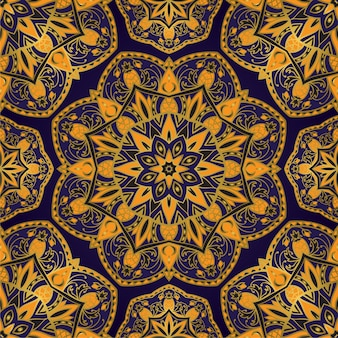 Niebieski i żółty wzór z mandalą.