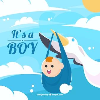 Niebieski to tło chłopca z bocianem