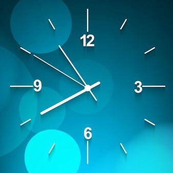 Niebieski zegar ścienny w tle