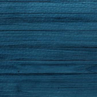 Niebieskie drewniane teksturowane tło projektu