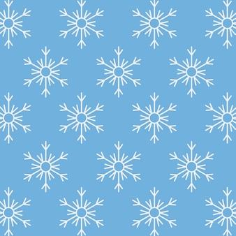 Niebieskie i białe płatki śniegu w sezonie zimowym