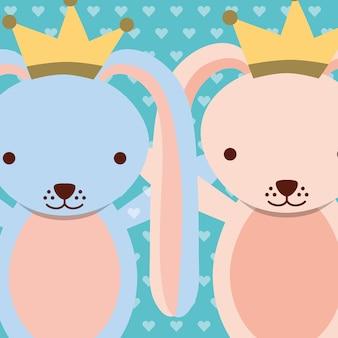 Niebieskie i różowe króliki sobie korony kropki tło