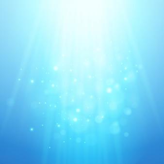 Niebieskie promienie światła. wektorowy bokeh zamazany tło