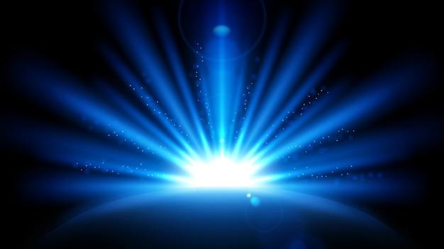 Niebieskie promienie z flara obiektywu na białym na czarnym tle