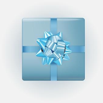 Niebieskie pudełko z kokardą i wstążką.