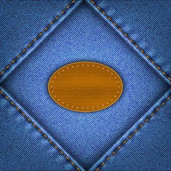 Niebieskie shabby jeans tło ze skórzaną etykietą