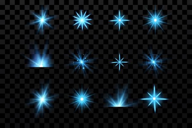 Niebieskie świecące drobinki gwiazd na przezroczystym tle