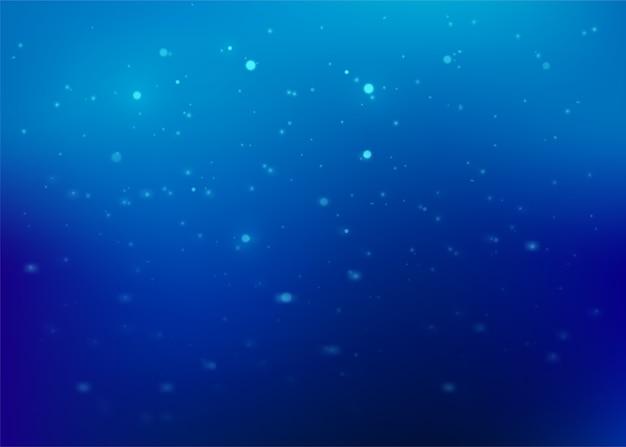 Niebieskie tło abstrakcyjne. tekstura drobinek brokatu z efektem błyszczącego światła.