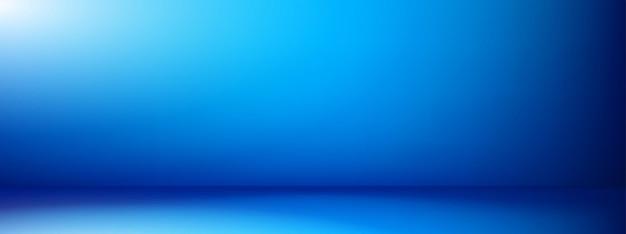 Niebieskie tło puste. pusty pokój z niebieskim tłem gradientowym. niebieski pusty pokój studio do lokowania produktu lub jako szablon projektu.