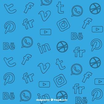 Niebieskie tło z ozdobnymi sieci społecznych ikon