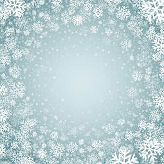 Niebieskie tło z tłem płatki śniegu