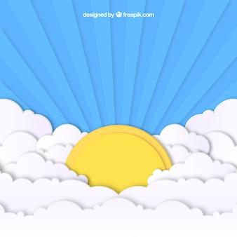 Niebo z chmurami i dużym słońca tłem w papierowej teksturze
