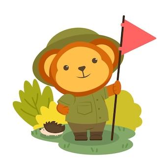 Niedźwiedź postać zwierzęcia w ubraniach turystycznych i trzymająca flagę