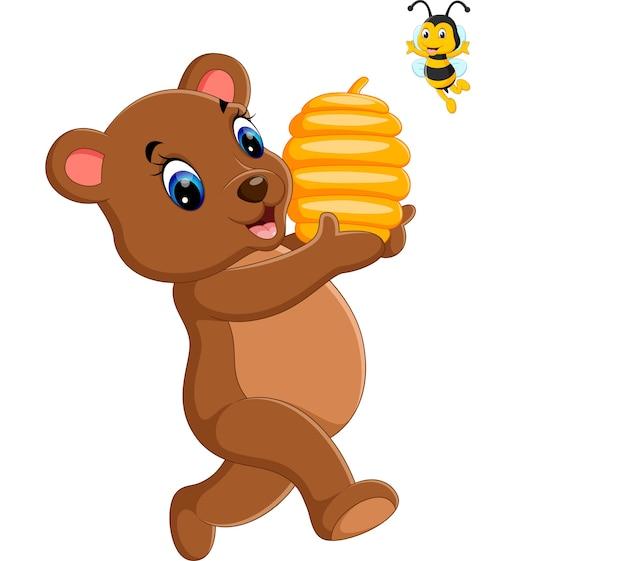 Niedźwiedź trzyma ula