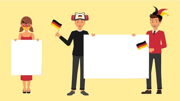 Niemieccy fani ze sportowymi akcesoriami flaga niemiec i puste banery