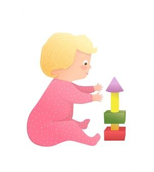 Niemowlę ładna blondynka maluch dziewczyna siedzi, grając w piramidę zabawek w przedszkolu