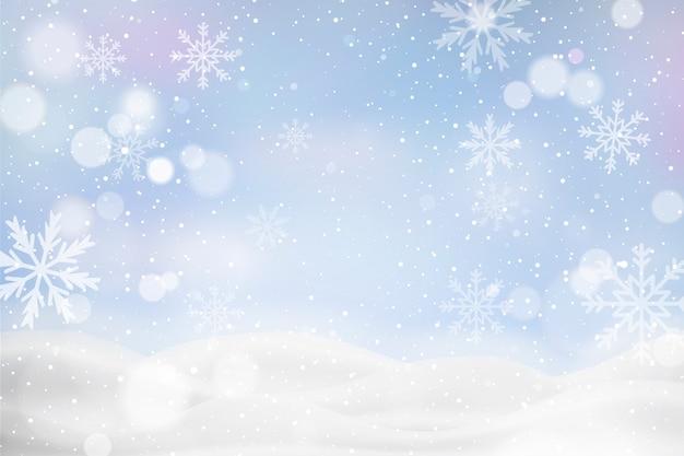 Nieostry zimowy krajobraz z płatkami śniegu
