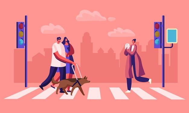 Niepełnosprawni i zdrowi piesi ze zwierzętami przechodzącymi przez skrzyżowanie dróg w mieście