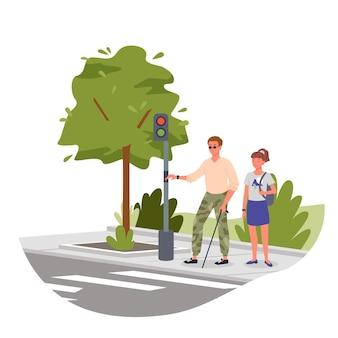 Niepełnosprawny niewidomy trzymający laskę, idący przez przejście dla pieszych z sygnalizacją świetlną