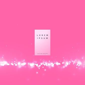 Niesamowite bokeh różowe tło z efektem cząstek