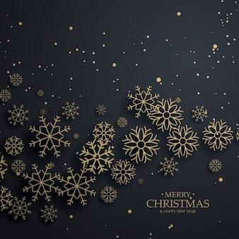 Niesamowite czarne tło z złota płatki śniegu Wesołych Świąt