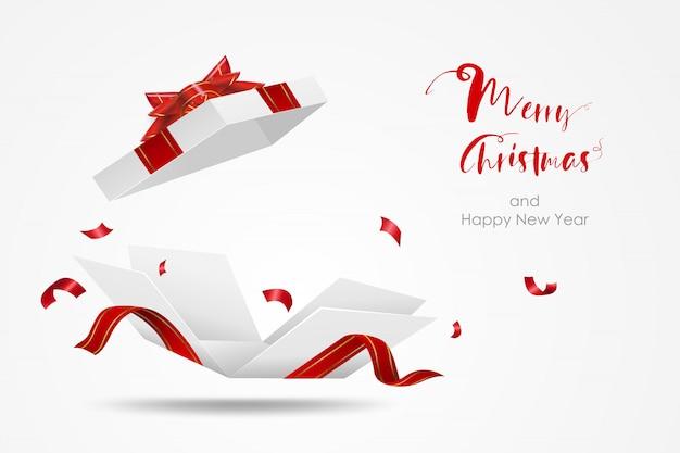 Niespodzianka białe pudełko z czerwoną wstążką. otwórz pudełko na białym tle. wesołych świąt i szczęśliwego nowego roku.