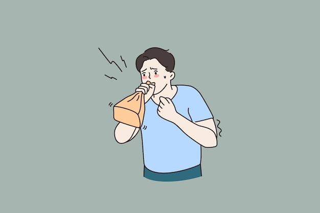 Niespokojny mężczyzna oddycha, cierpi na atak paniki
