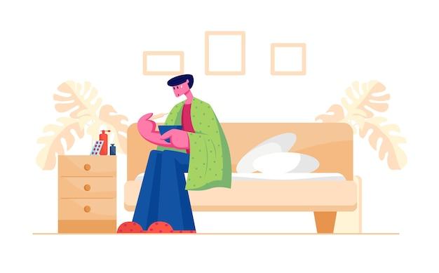 Nieszczęśliwy chory mężczyzna siedzi na sofie zawiniętej w kratę i ma gorączkę, mierząc temperaturę za pomocą termometru i szerokiej gamy lekarstw i narkotyków, stojąc na nocnym stoliku.