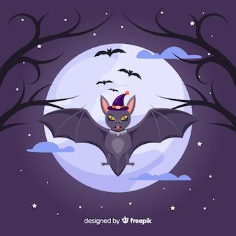 Nietoperz z kapeluszem czarownicy w noc pełni księżyca