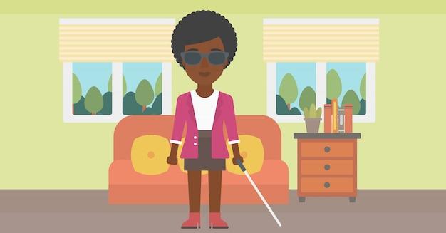 Niewidoma kobieta z kijem.