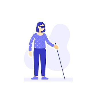 Niewidoma kobieta z okularami przeciwsłonecznymi i laską spaceru