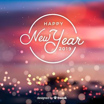 Niewyraźne światła nowy rok tło