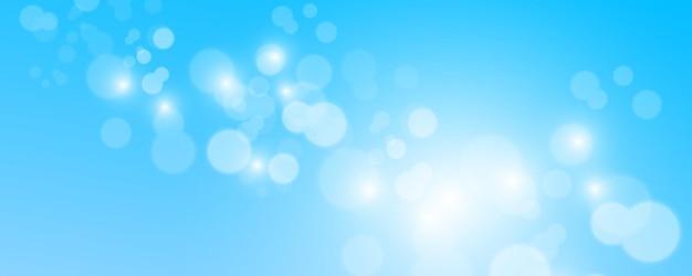 Niewyraźne elementy błyszczące światła. błyszczy na białym tle na niebieskim tle.