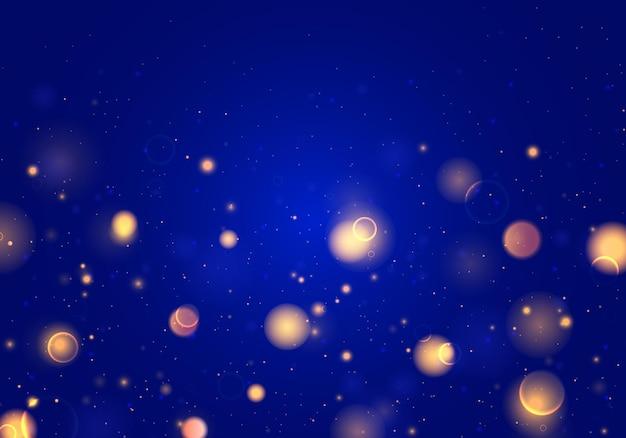 Niewyraźne światło bokeh na ciemnoniebieskim tle. streszczenie brokat niewyraźne iskry.