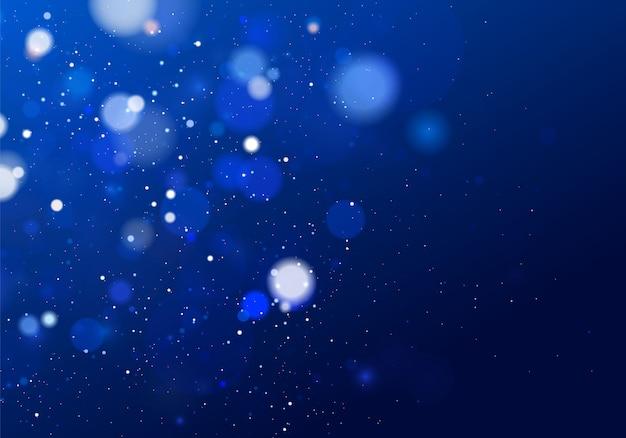 Niewyraźne światło bokeh na ciemnym niebieskim tle. streszczenie brokat nieostre migające gwiazdy i iskry.
