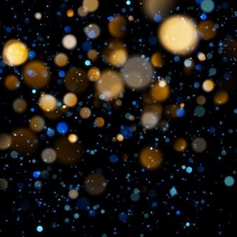 Niewyraźne światło bokeh na ciemnym niebieskim tle. święta bożego narodzenia i nowego roku. streszczenie brokat nieostre migające gwiazdy i iskry.