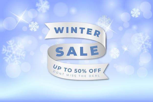 Niewyraźne zimowe pojęcie sprzedaży ze wstążką
