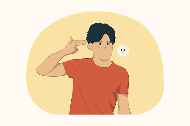 Niezadowolony młody człowiek wskazuje palcami w głowę, jakby chciał się zastrzelić