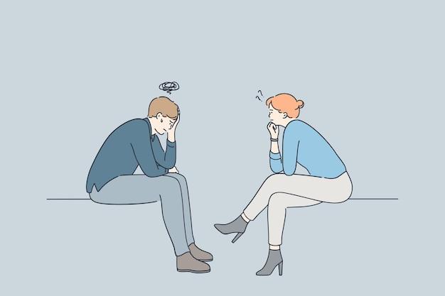 Niezadowolony pacjent siedzi i komunikuje się z kobietą