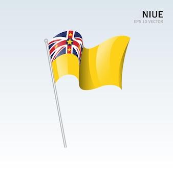 Niue macha flagą na szarym tle
